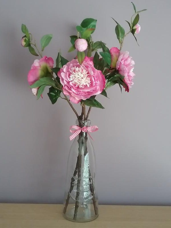 Pink Peonies In A Glass Bottle