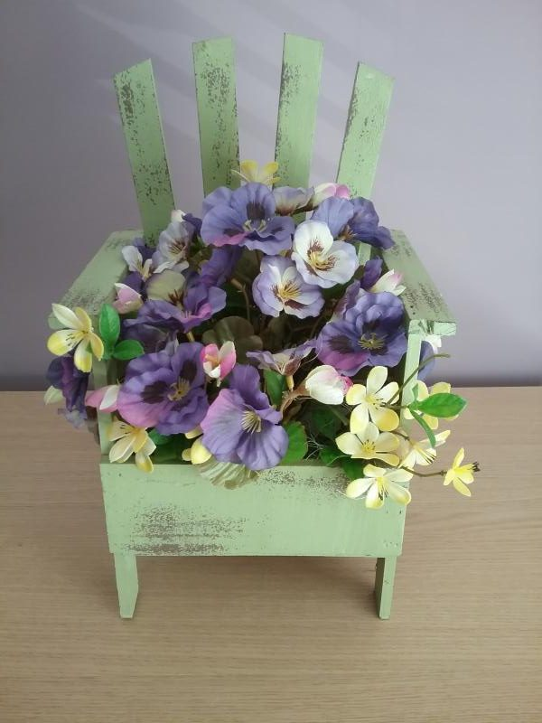 Floral Display In A Mini Chair